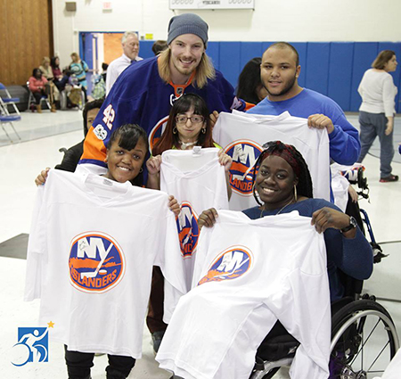 The New York Islanders playing wheelchair hockey with Henry Viscardi School students.