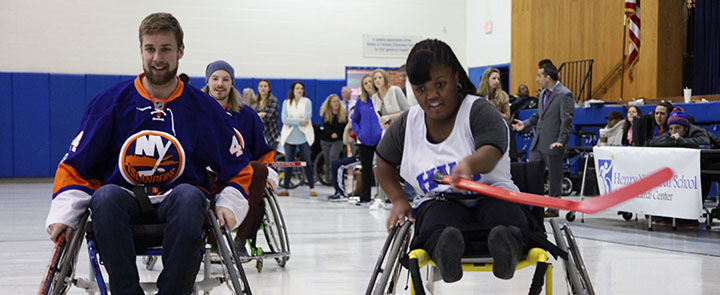New York Islanders Forward and Henry Viscardi School student athlete chasing the puck.