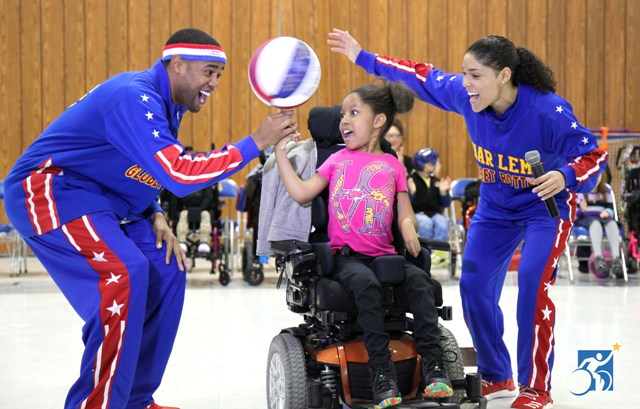 Harlem Globetrotters play basketball with Henry Viscardi School students.